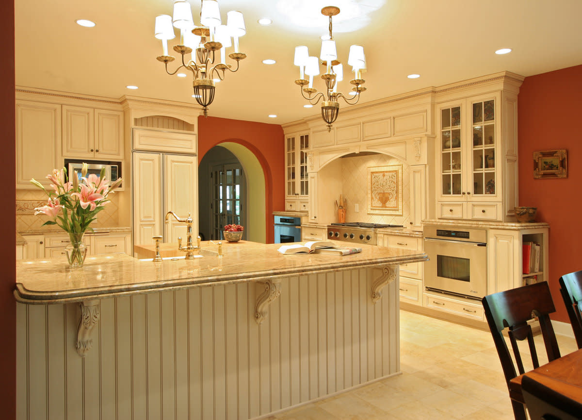 Old World Kitchen Design Options With White Glazed Cabinets With Glass  Doors And Double Chandeliers