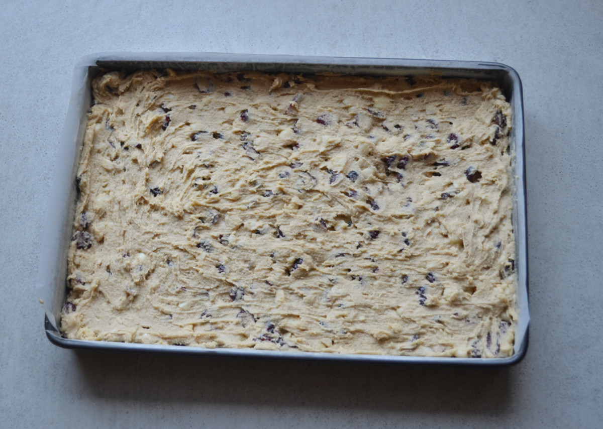 Macadamia and Cranberry slice mixture in baking tray.
