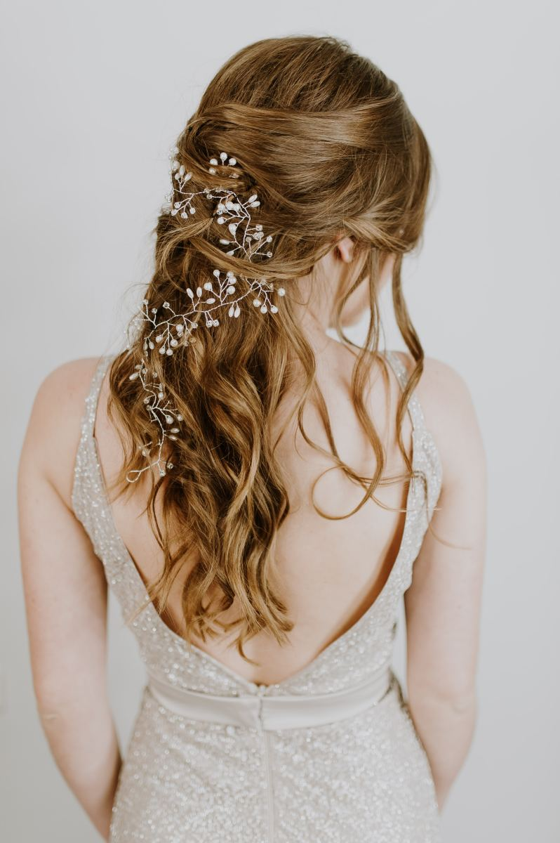 This long-haired beauty illustrates how lovely hair can look with a few gorgeous accessories.