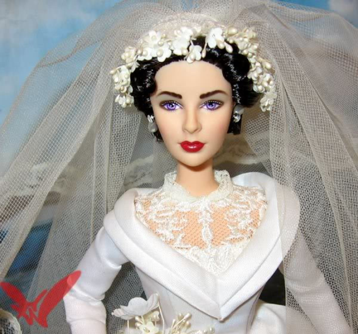 Elizabeth Taylor Barbie Doll in bridal attire and beautiful bridal head piece and veil