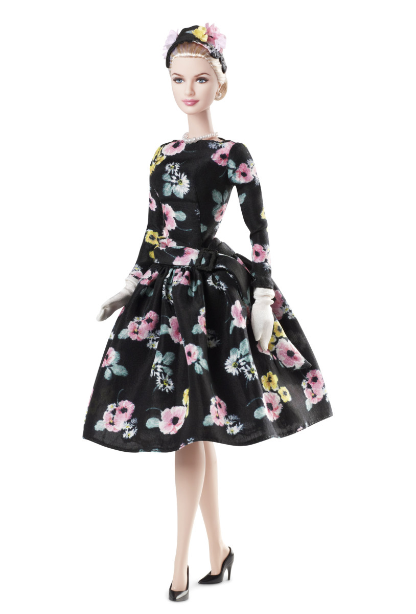 Grace Kelly Barbie Doll in beautiful flowered dress with black background and flowers in her hair
