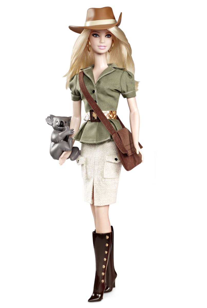 Barbie Doll in Australian garments holding a Koala bear, wearing boots and a green jacket and tan skirt - very fashionable