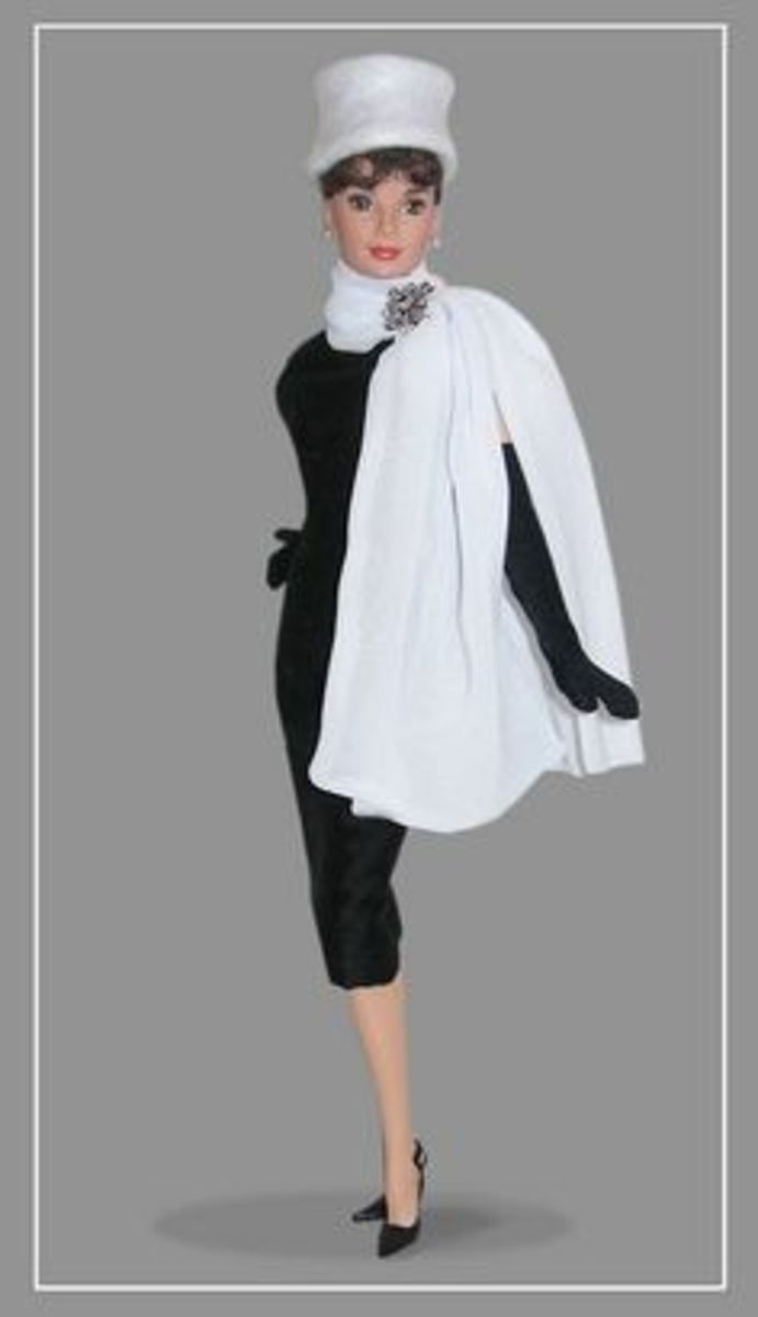 Audrey Hepburn Barbie Doll in classy black and white with white hat and white mink jacket and classic little black dress
