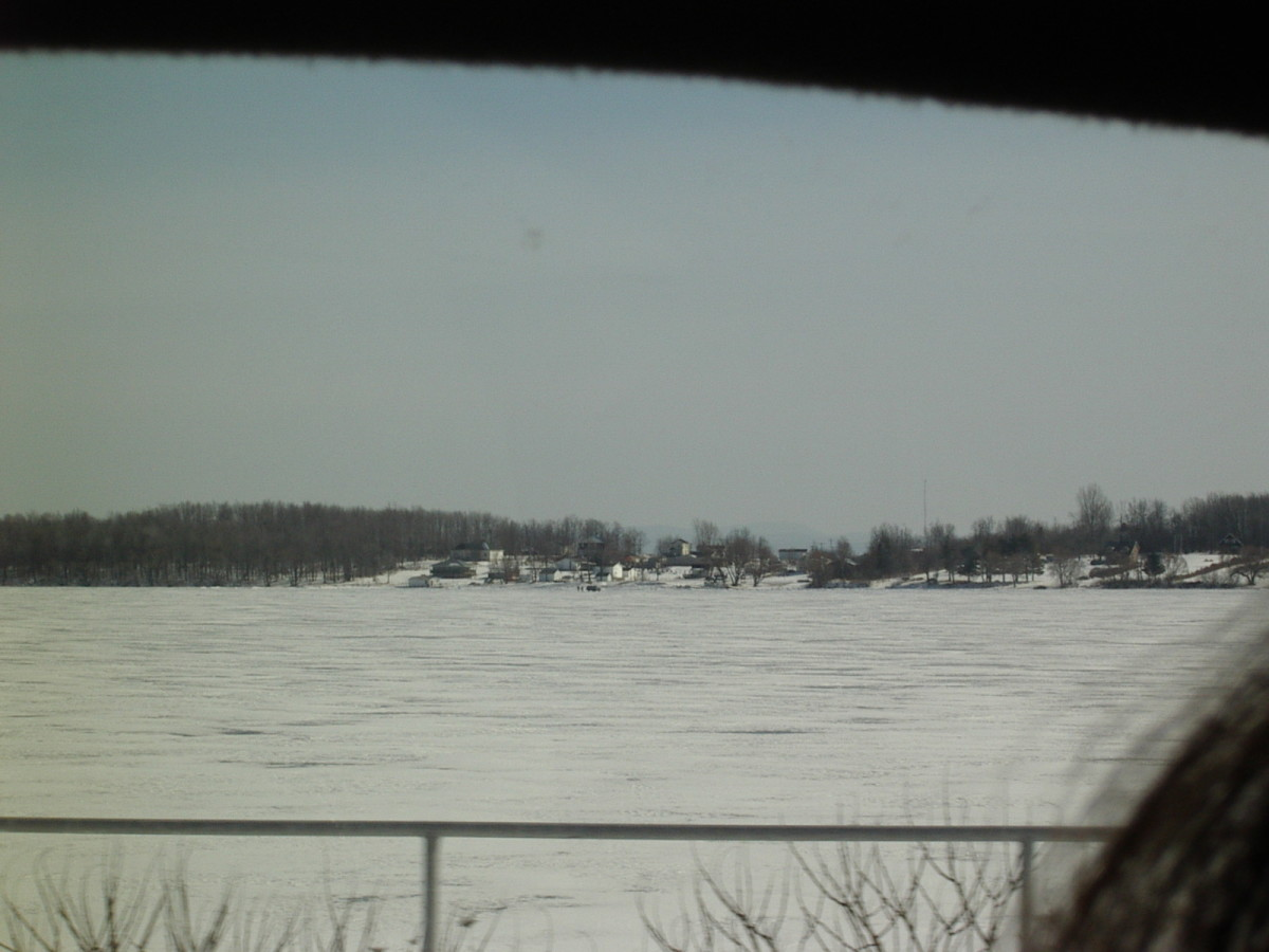 Pilon Island in winter, across the frozen St. Lawrence.