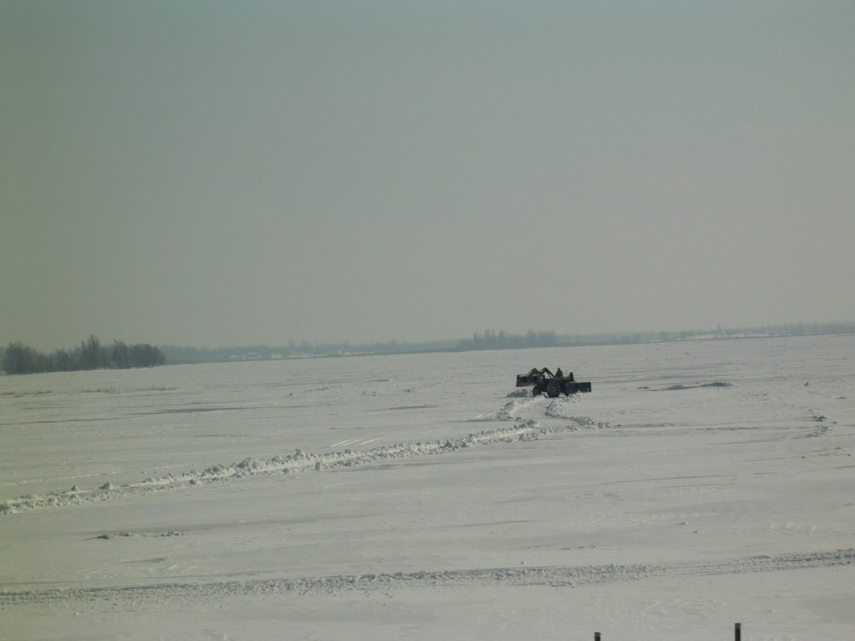 Clearing a route across the frozen St. Lawrence River.