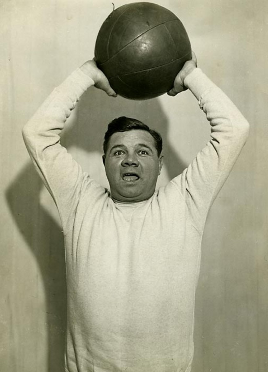 The Babe throwing the medicine ball at Artie McGovern's gym in 1932.  Exercise saved his career.