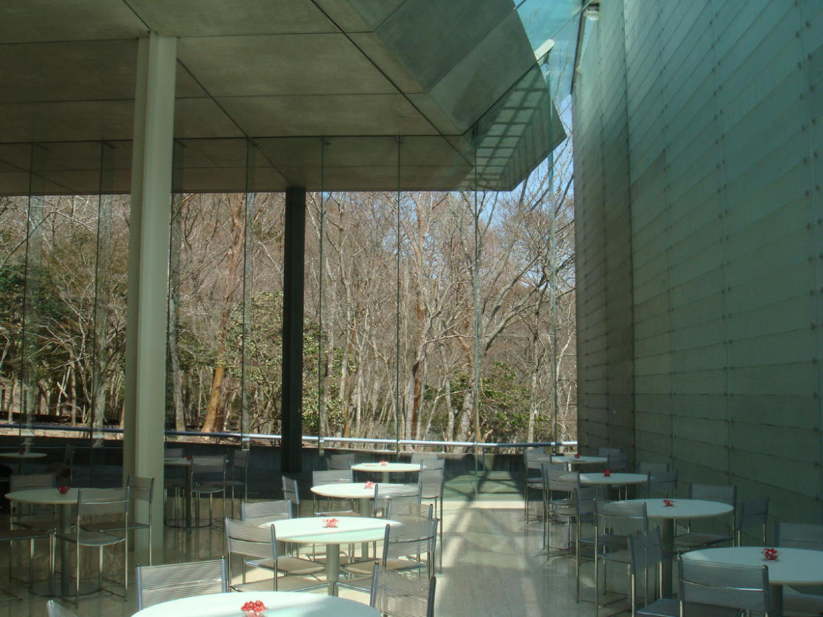 Cafe at Pola Museum. Can you appreciate the huge optic fiber covered wall, the glass wall to the forest and the natural light that seeps through.