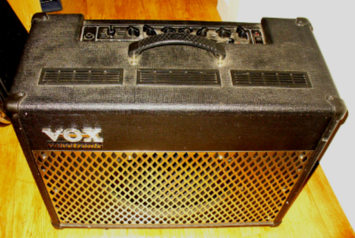 "The Vox AD50VT was Vox's 50-watt entry into the hybrid amp market. Its warm sound stems from a 12AX7 tube in the preamp section, as well as a 12"" Celestion speaker which sits behind the chrome grill."