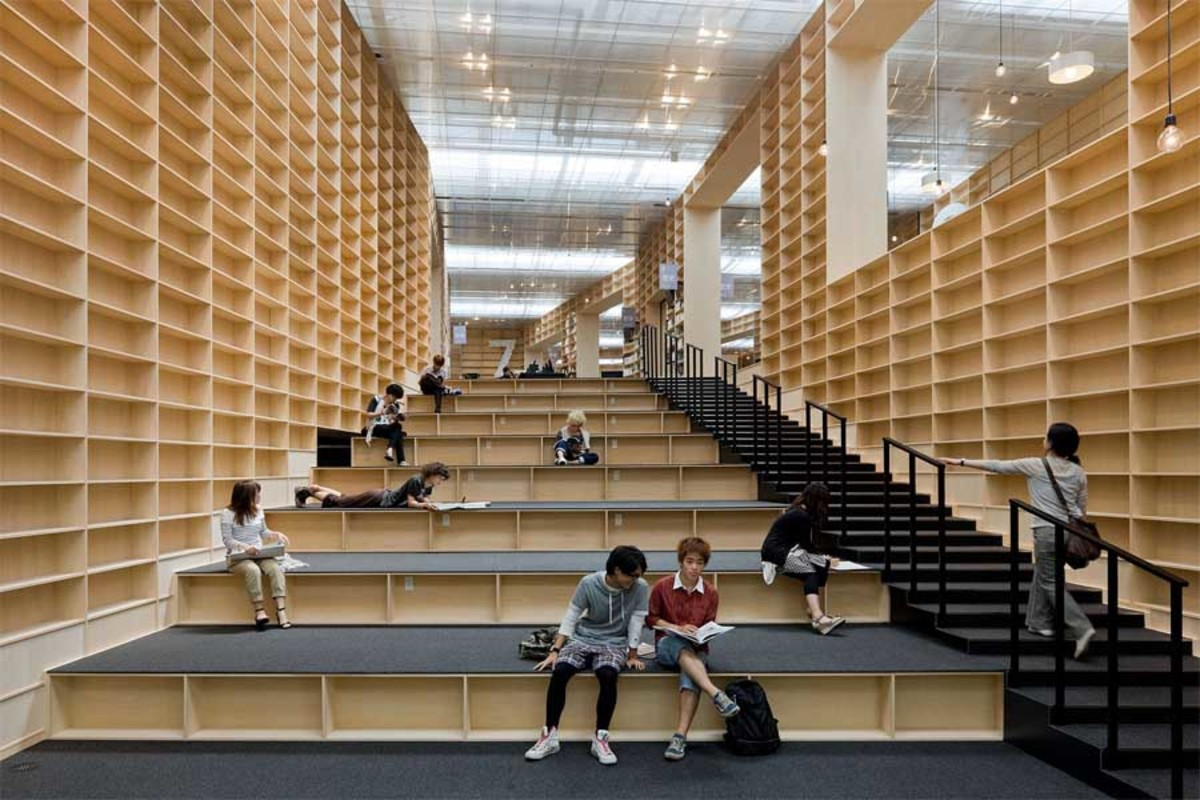 Way up to upper floor, sitting area, and shelves for books, all wrapped into a single space