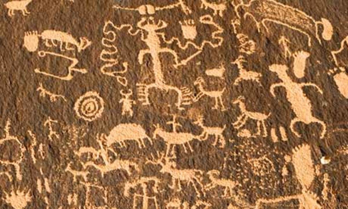 Figures cut into desert varnish by Native Americans, Utah.