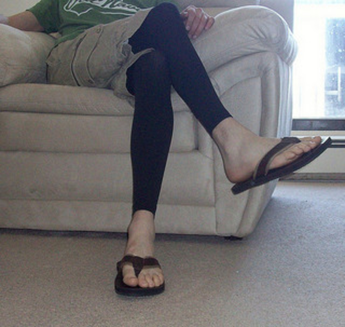 Black leggings worn with cargo shorts and sandals.