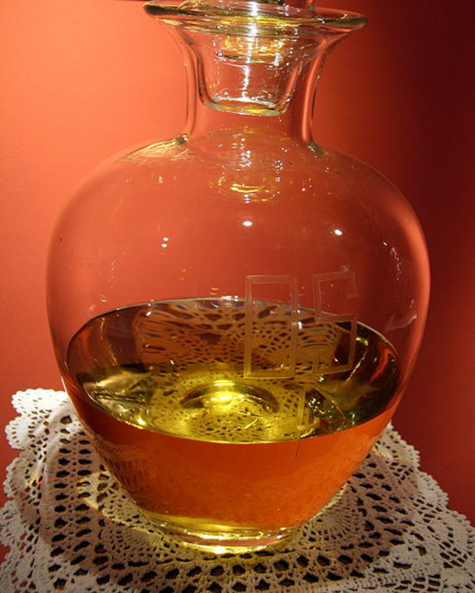 """A jar of consecrated oil for ritual purposes. Etched into the glass are the letters """"OS"""" for Oleum Sanctum, Latin for holy oil."""