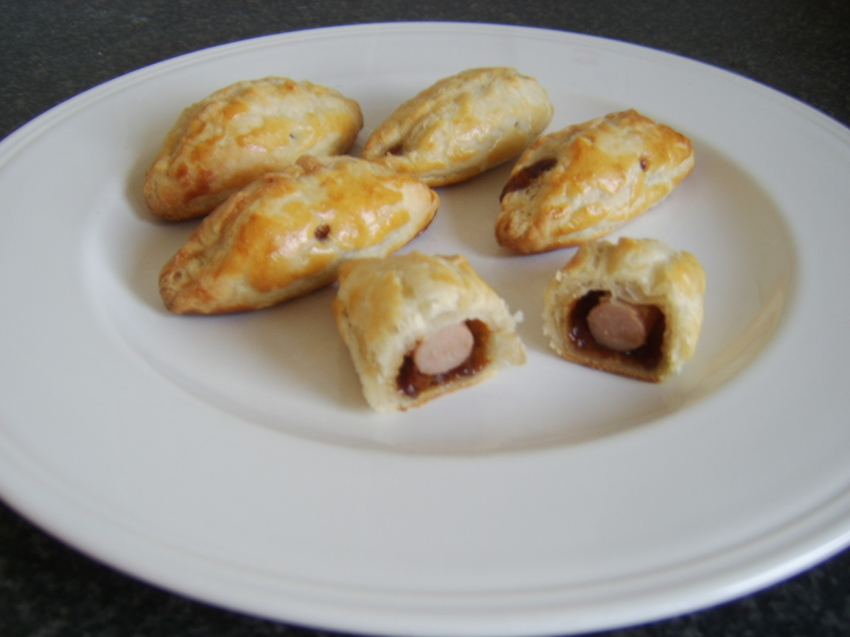 Cocktail sausages and pickle are contained in a crispy puff pastry crust