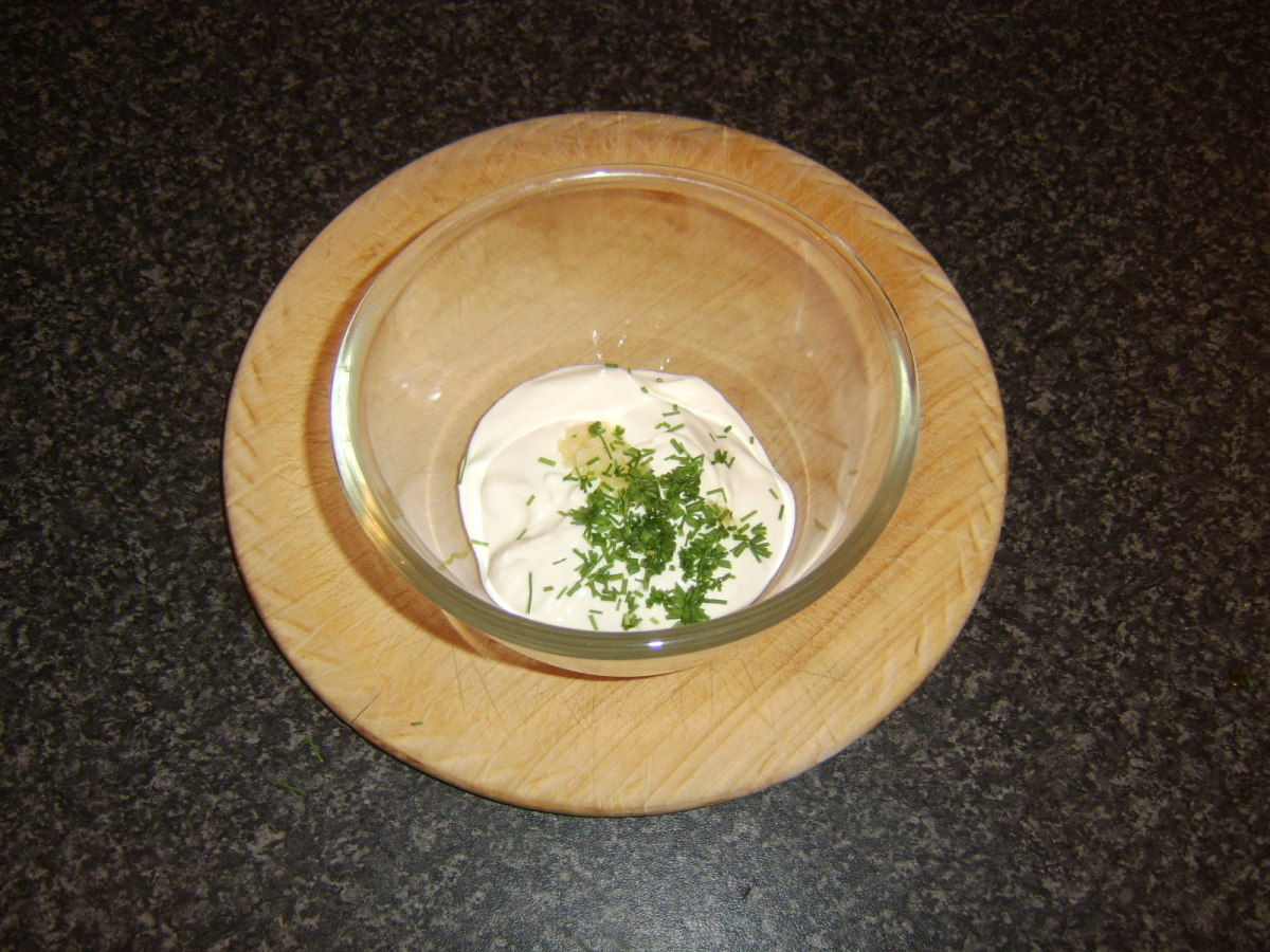 A simple dip of soured cream, garlic and chives is prepared