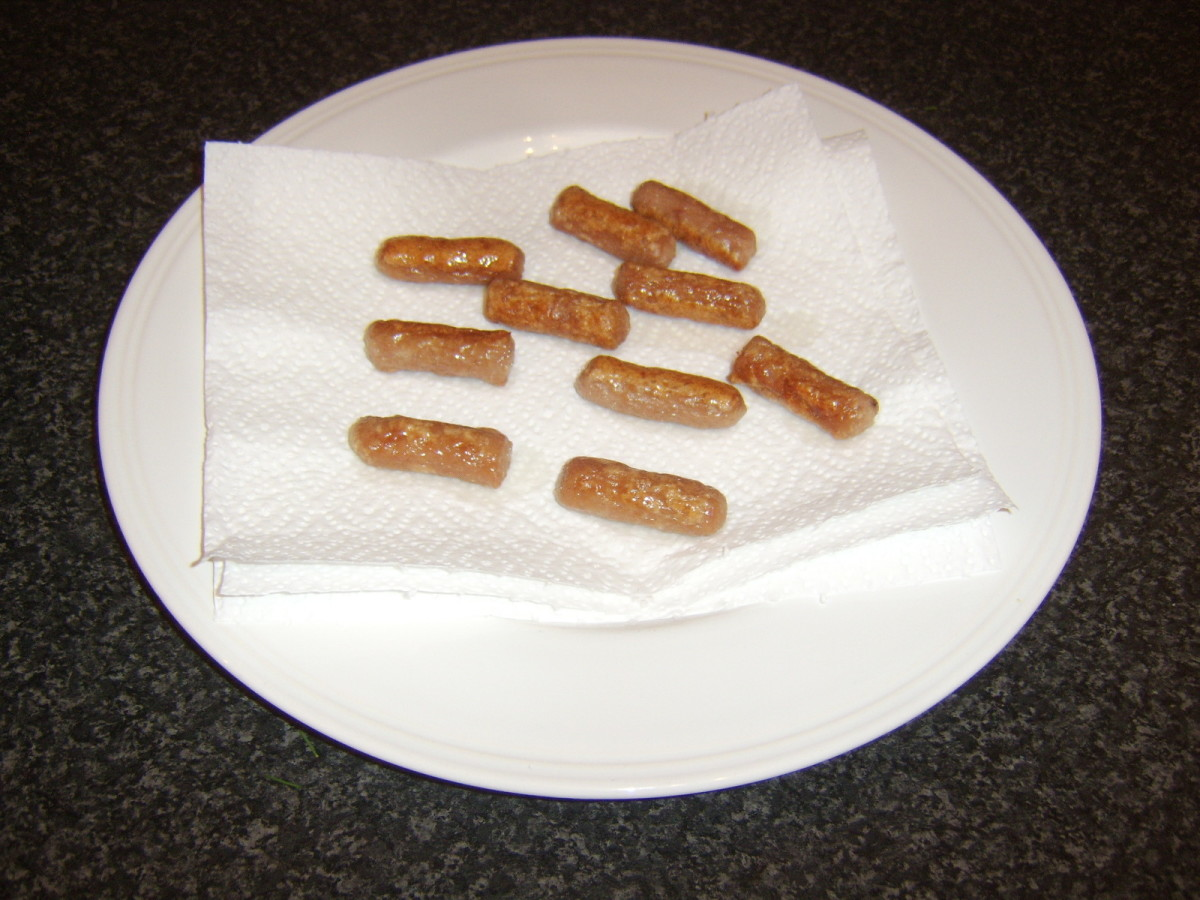 Wee Willie Winkie sausages are drained on kitchen paper after they are fried