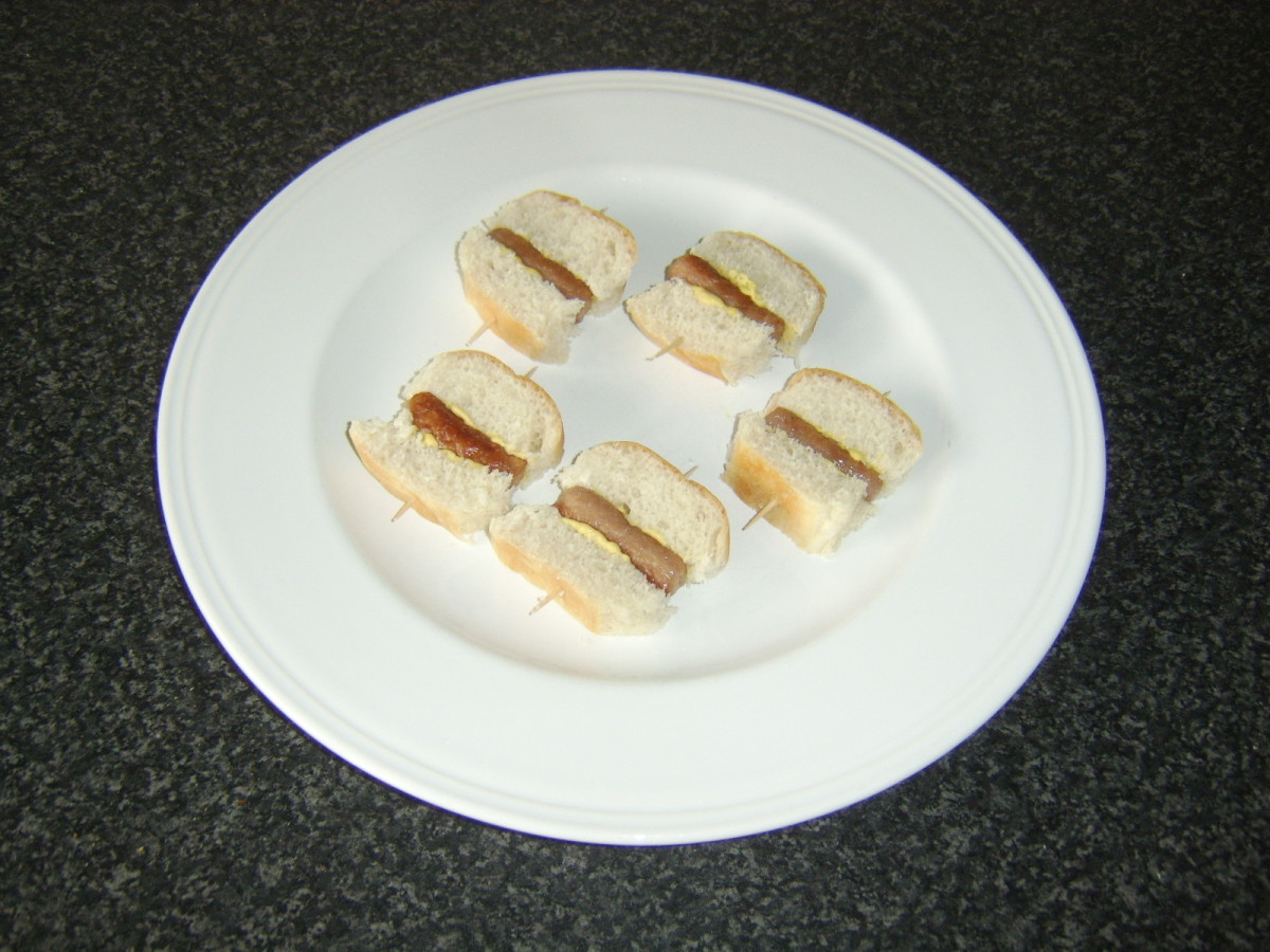 Sausages are skewered between two portions of the sub roll