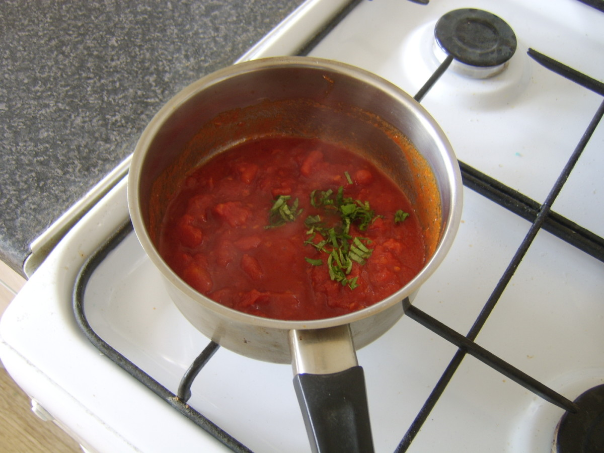 Tomatoes and basil are added to the spices