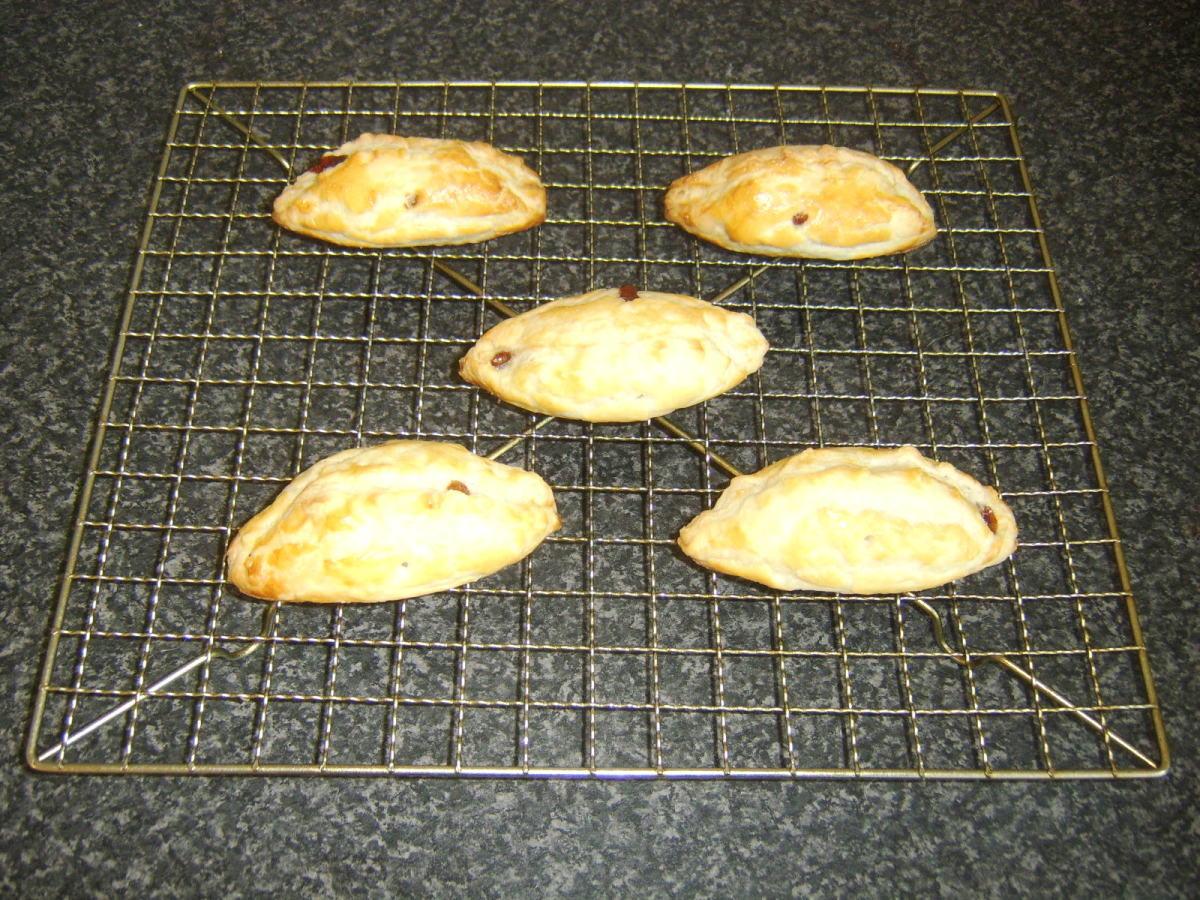 Pasties are rested and cooled on a wire rack