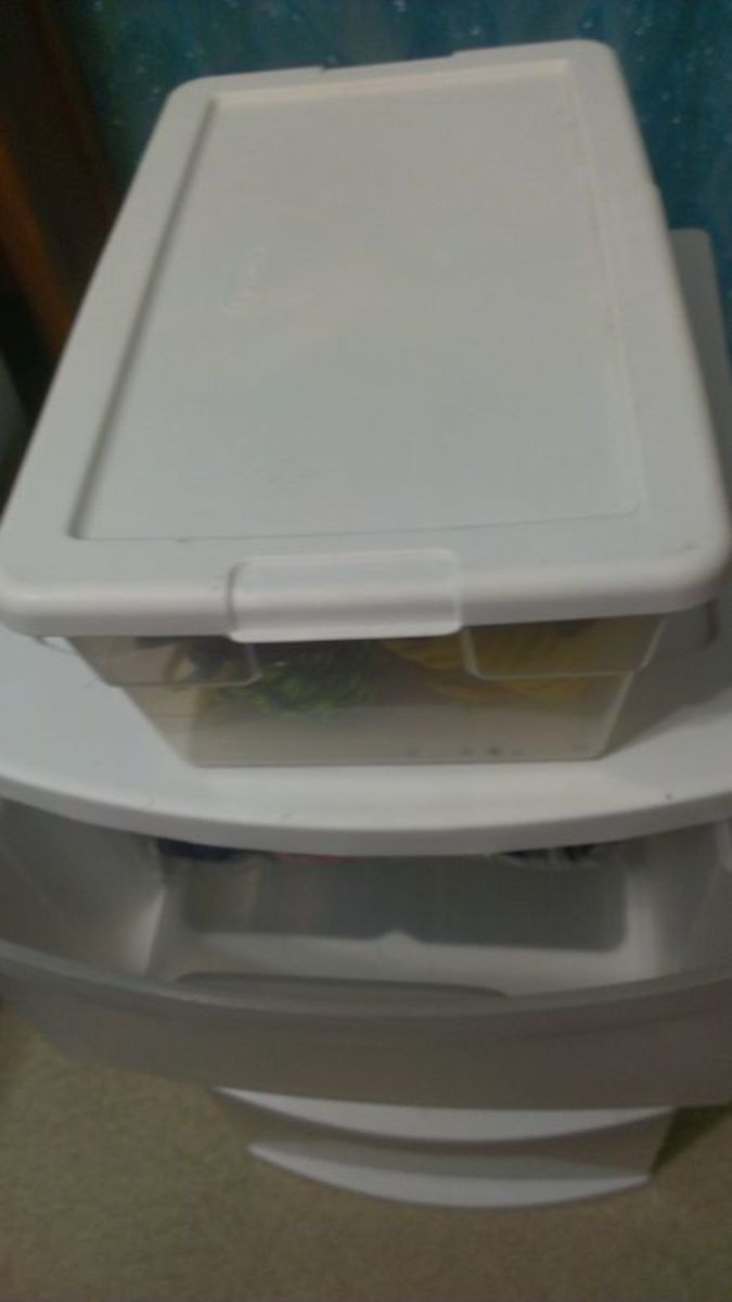 A plastic shoebox like this works perfectly for storing snacks in.  It fits right on top of the drawers, and it can hold a week's worth of goodies.