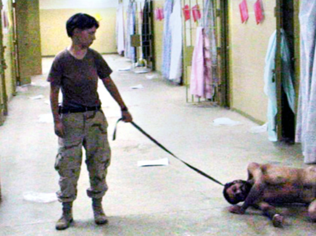 Photo of U.S. soldier and prisoner at Abu Ghraib, Iraq -- one of a number of similarly horrifying images that led to an investigation and court martials.