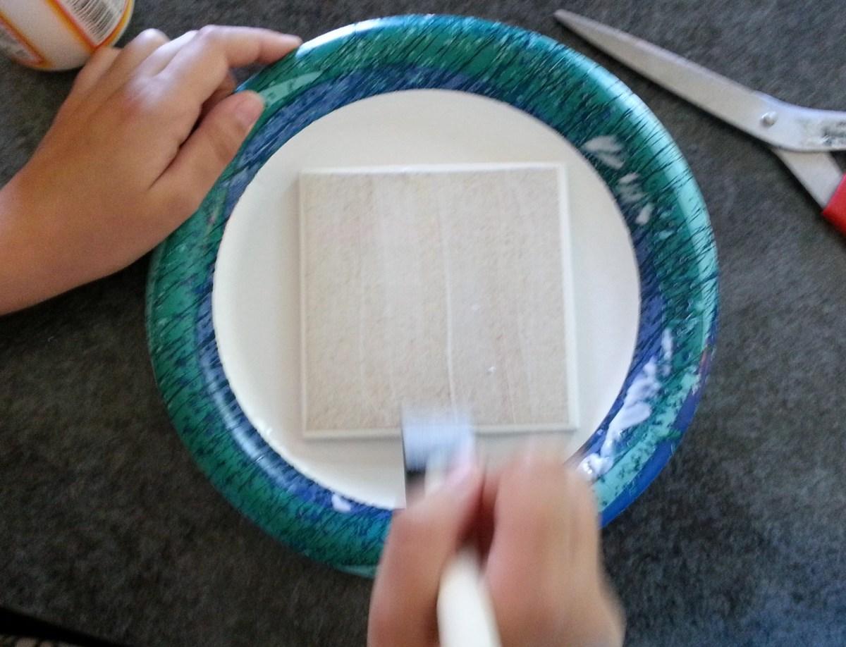 Put 2 - 3 coats of Modge Podge on your tile coaster.