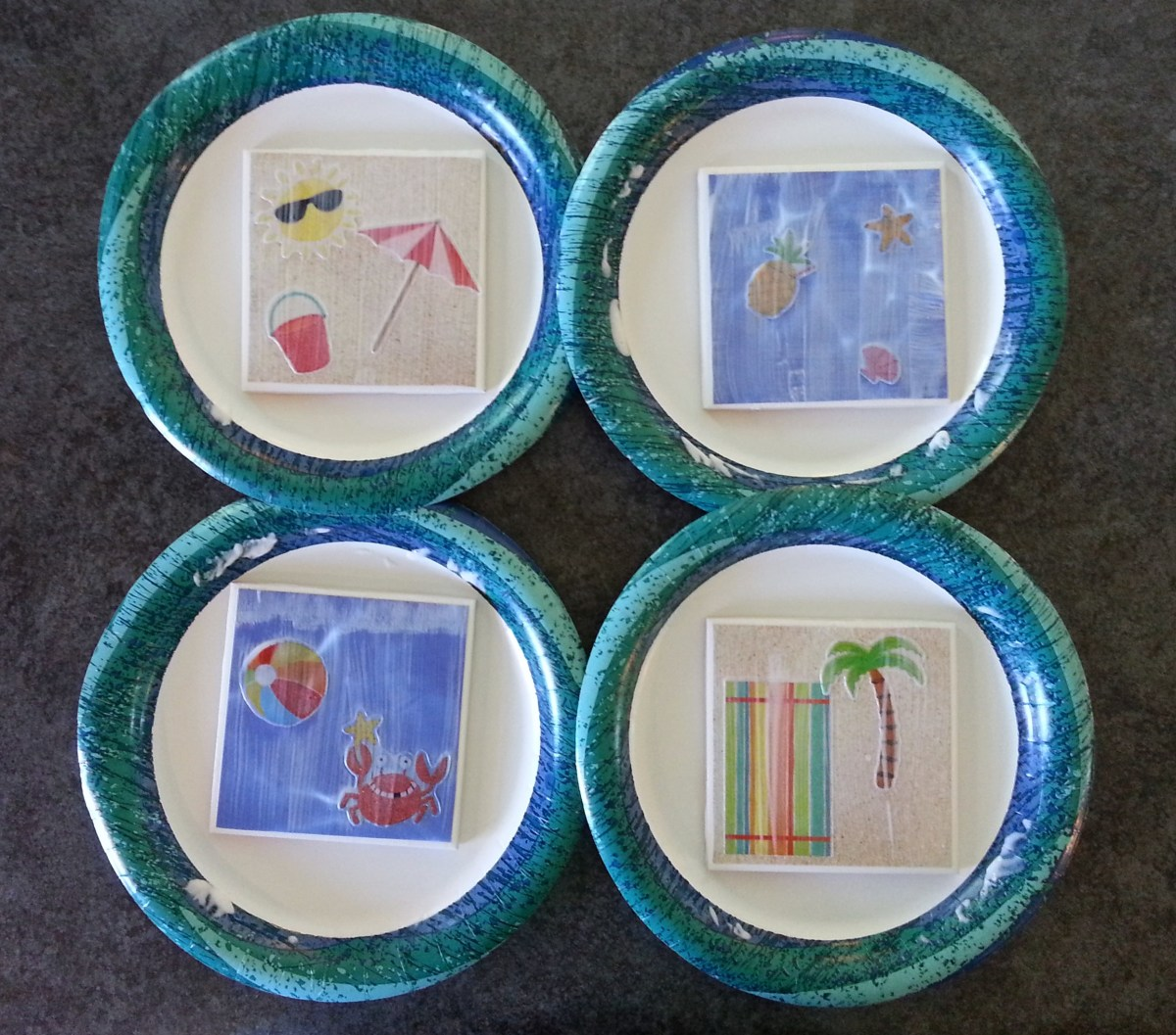 DIY tile coasters as they dry.  The Modge Podge will dry clear.