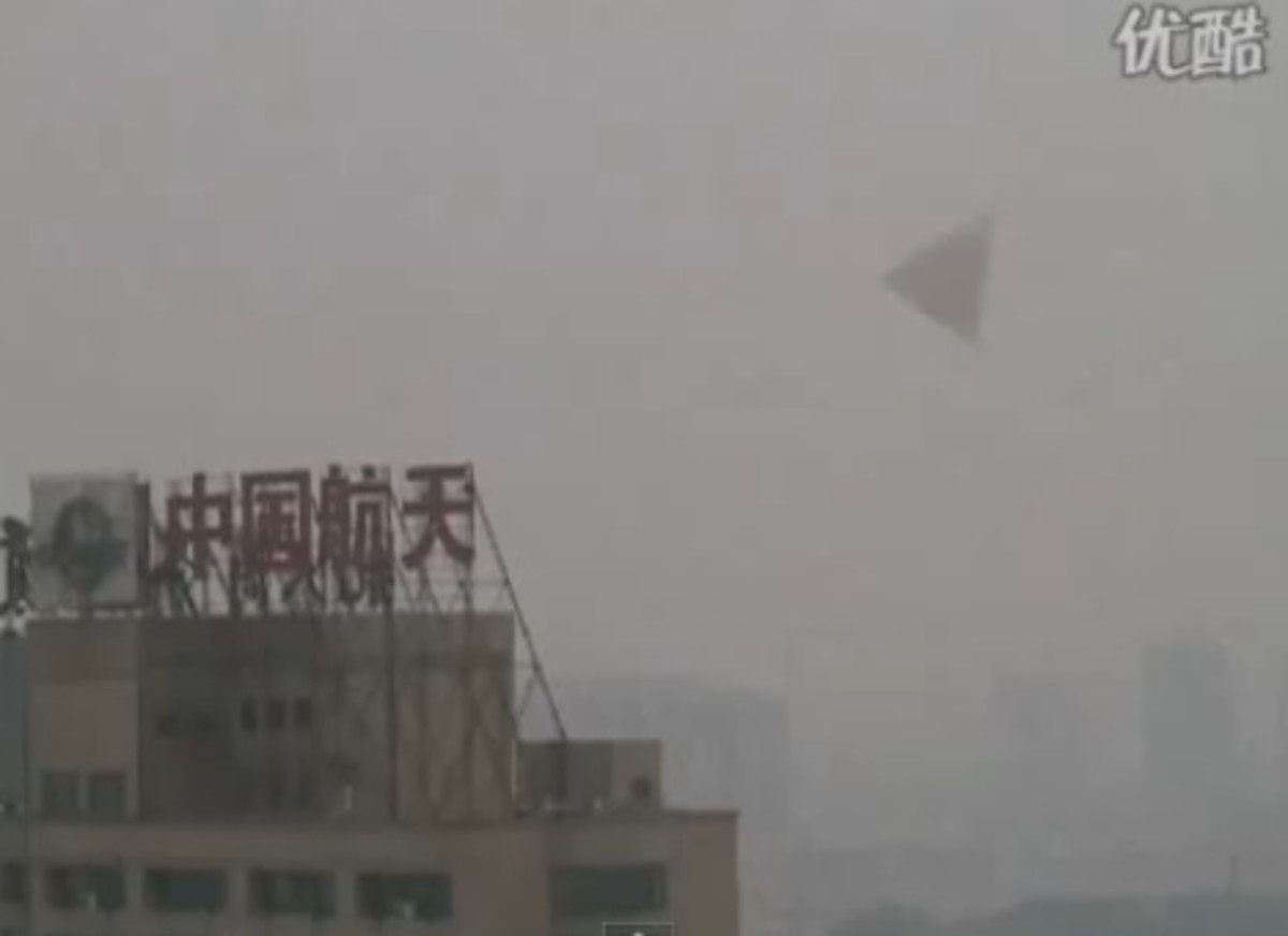 A potential triangle/pyramid UFO spotted over China.