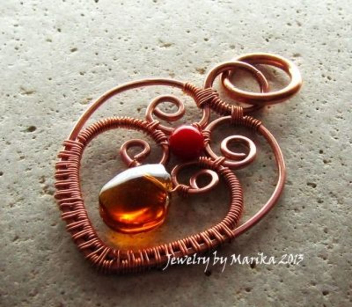 Here is a pendant I made from Jody's book - see the heart scroll shapes?