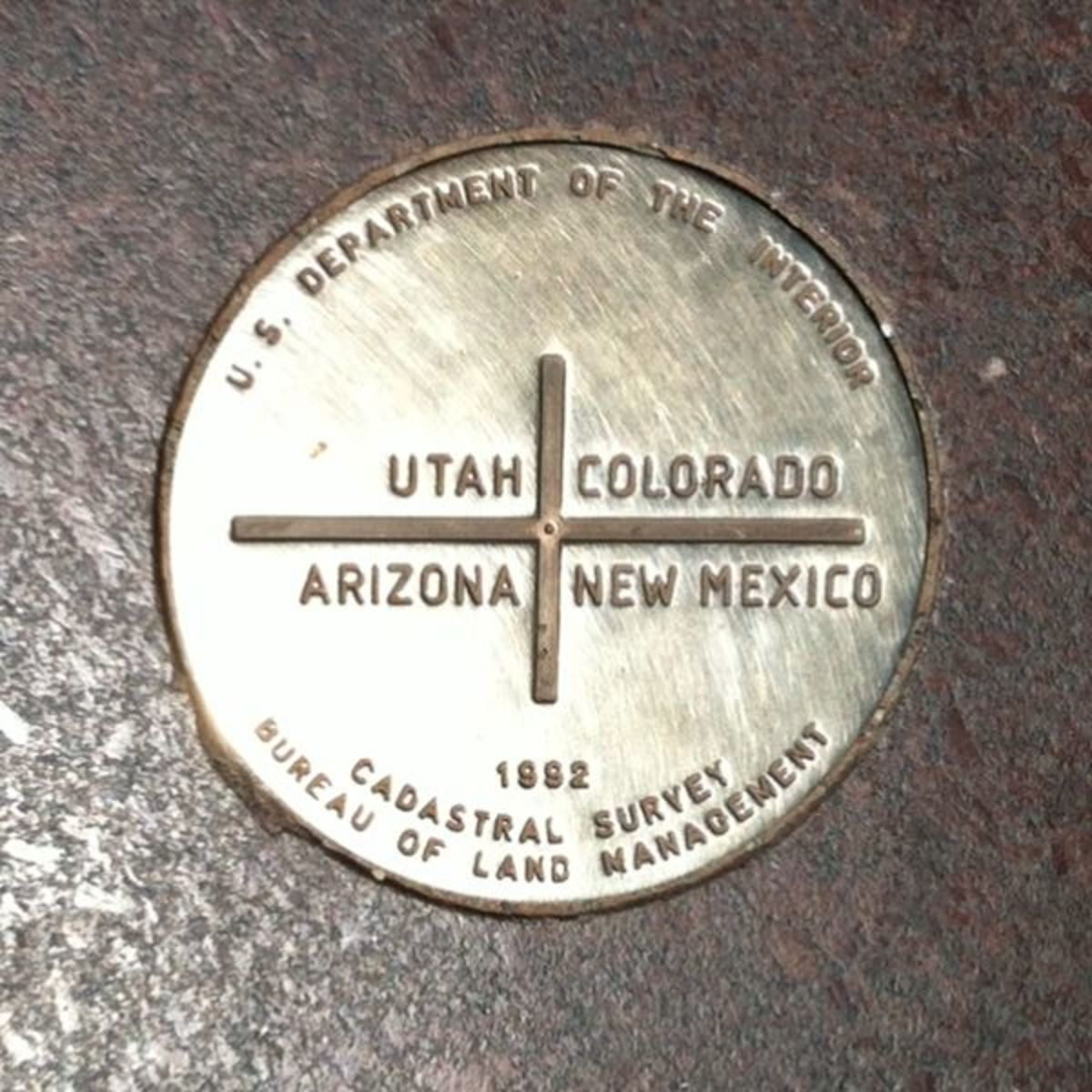 Close up of the four corners monument marker.