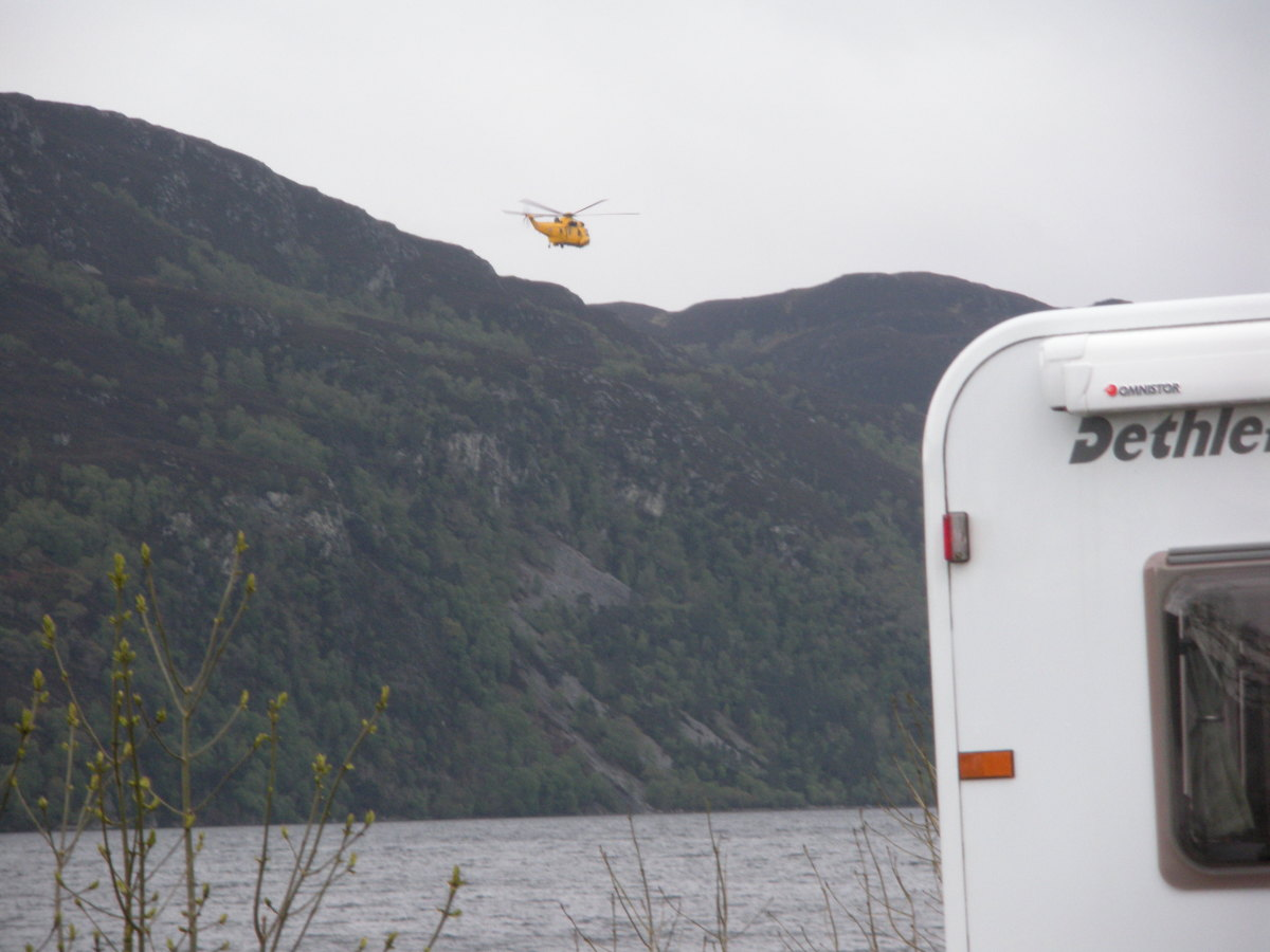 Helicopters and jets passing overhead occasionally break the sound of the lapping water.