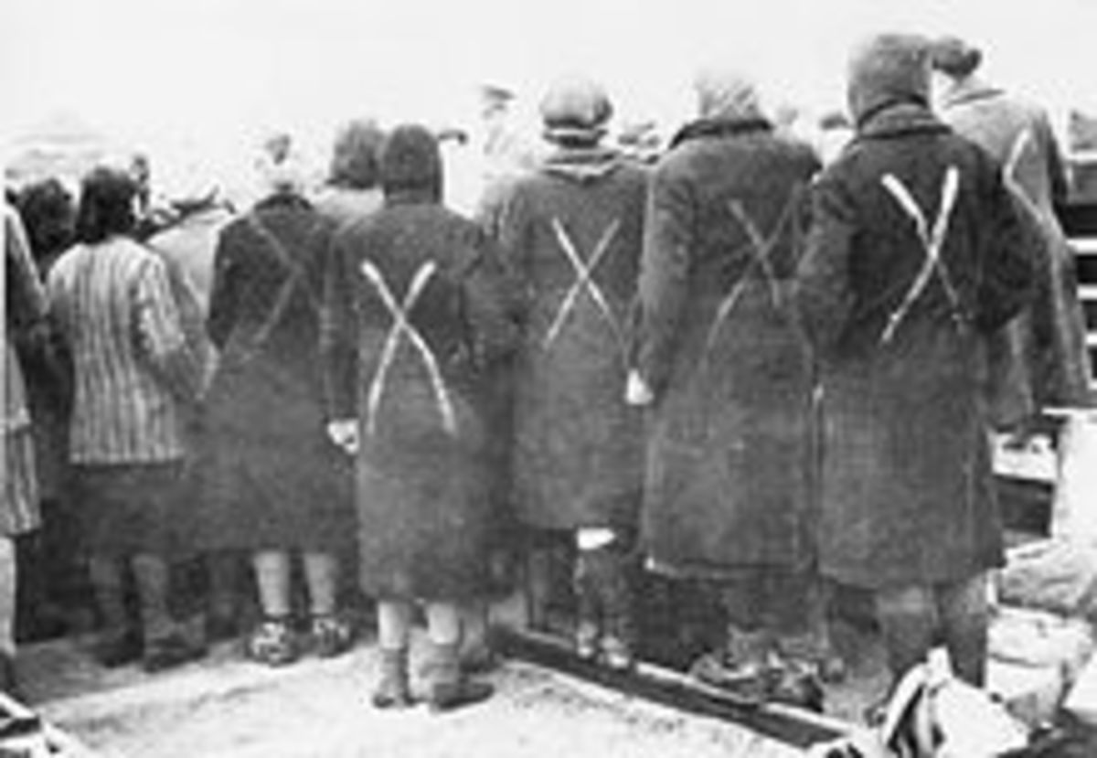 Female prisoners gathered when the Red Cross arrive to Ravensbrcck in April 1945. The white paint marks shows they are prisoners.
