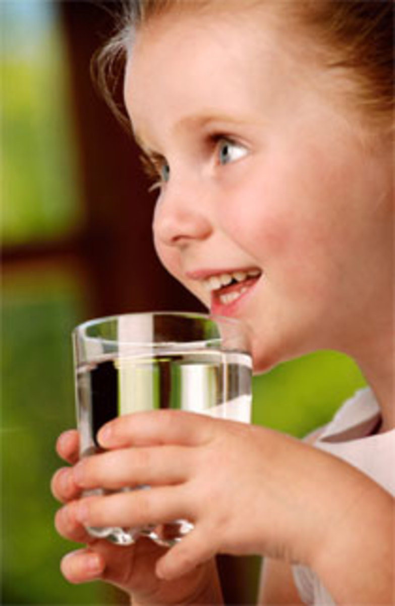 Child holding a glass of water.