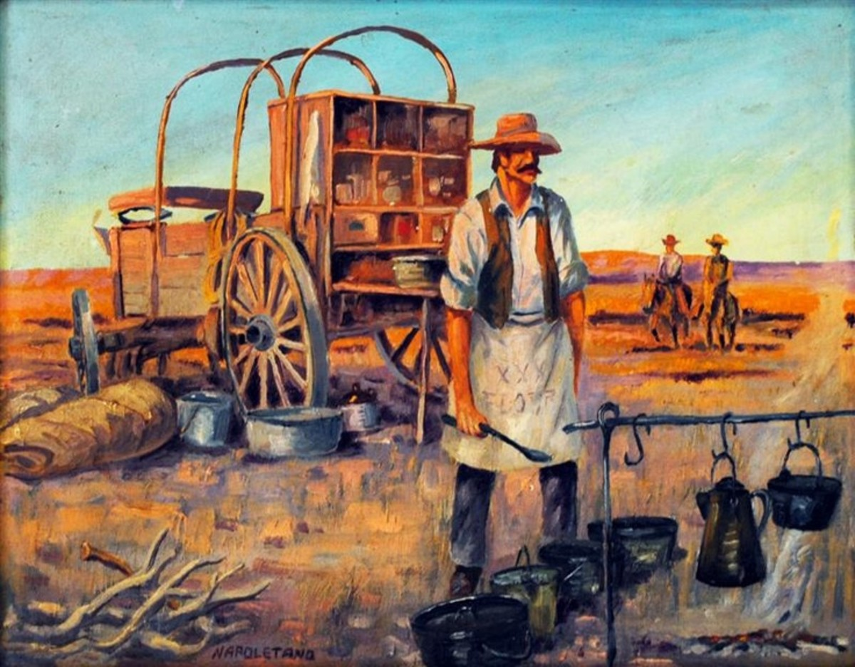 Here we have a old west chuck wagon with the cook preparing food for the hungry cowboys who will be showing up soon.