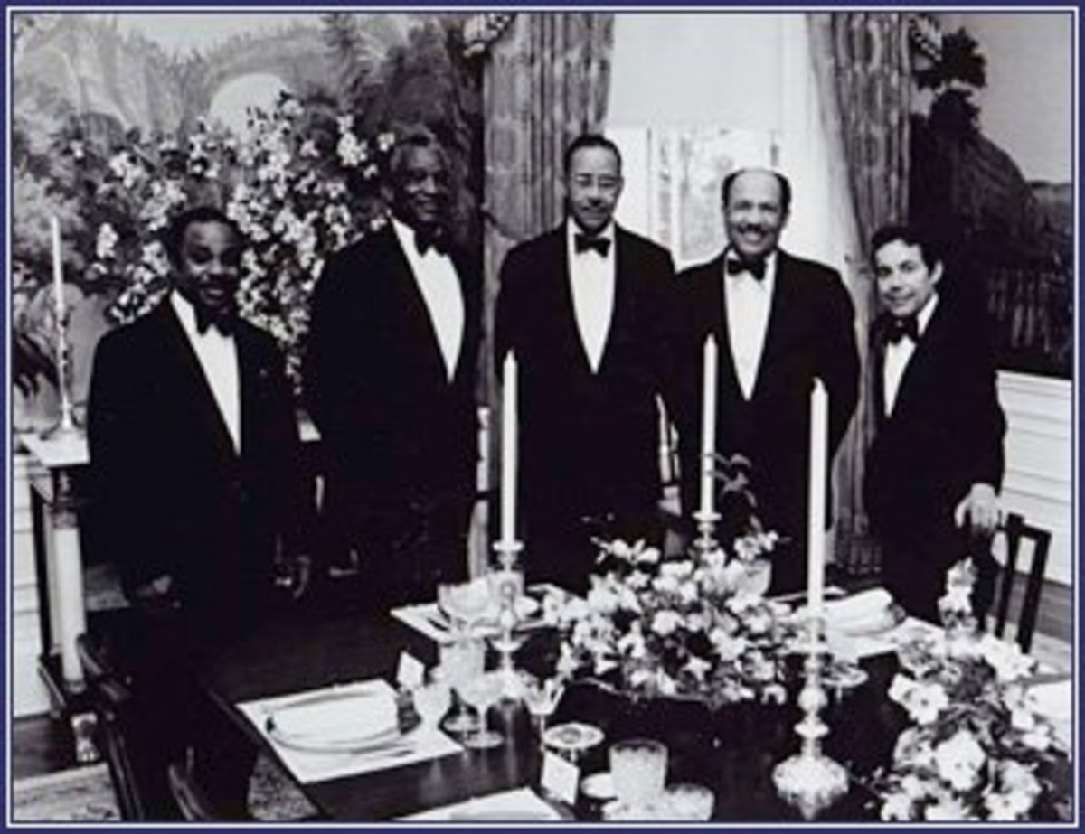 Mr. Eugene Allen (second from right) worked from 1952 to 1986 as a pantryman, a butler, and finally, the Maître d'.  Eugene Allen photo album, Smithsonian Center for Folklife and Cultural Heritage.