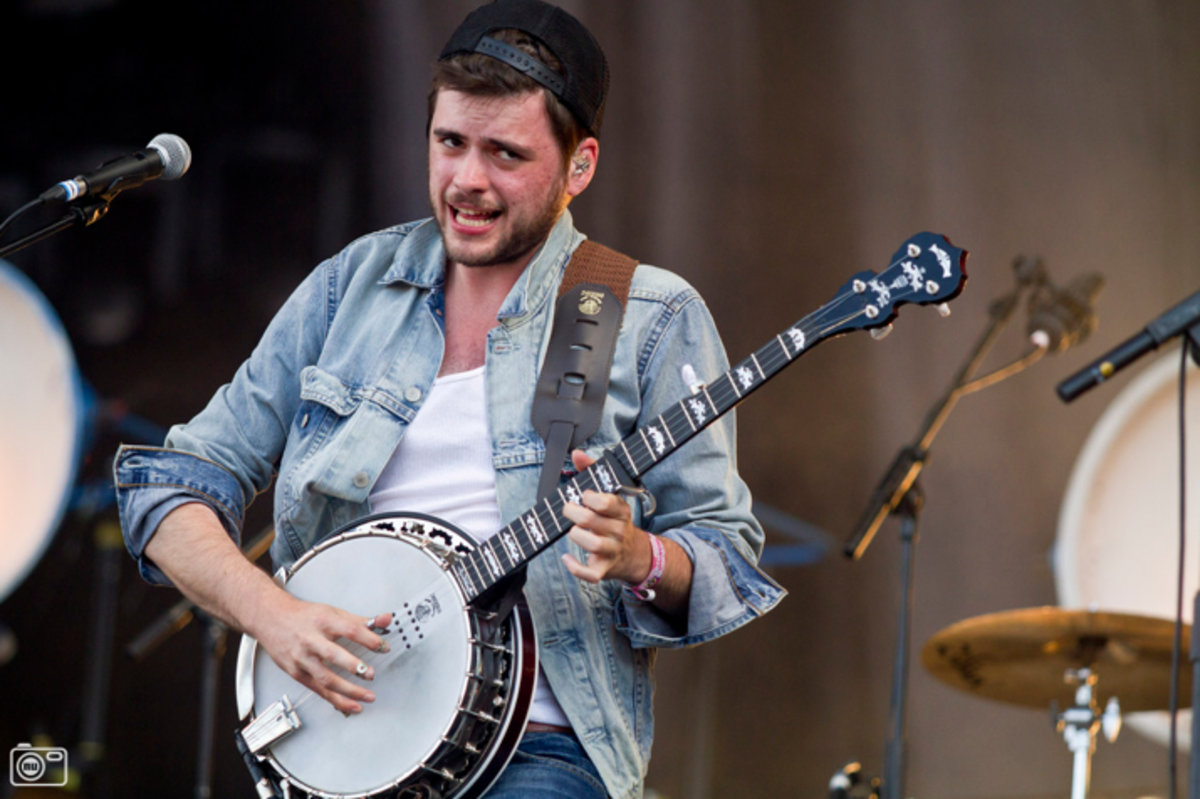 """Country"" Winston Marshall, the banjoist of Mumford and Sons.  Mumford and Sons won a 2013 Grammy (Best Album) for their popular album ""Babel."""