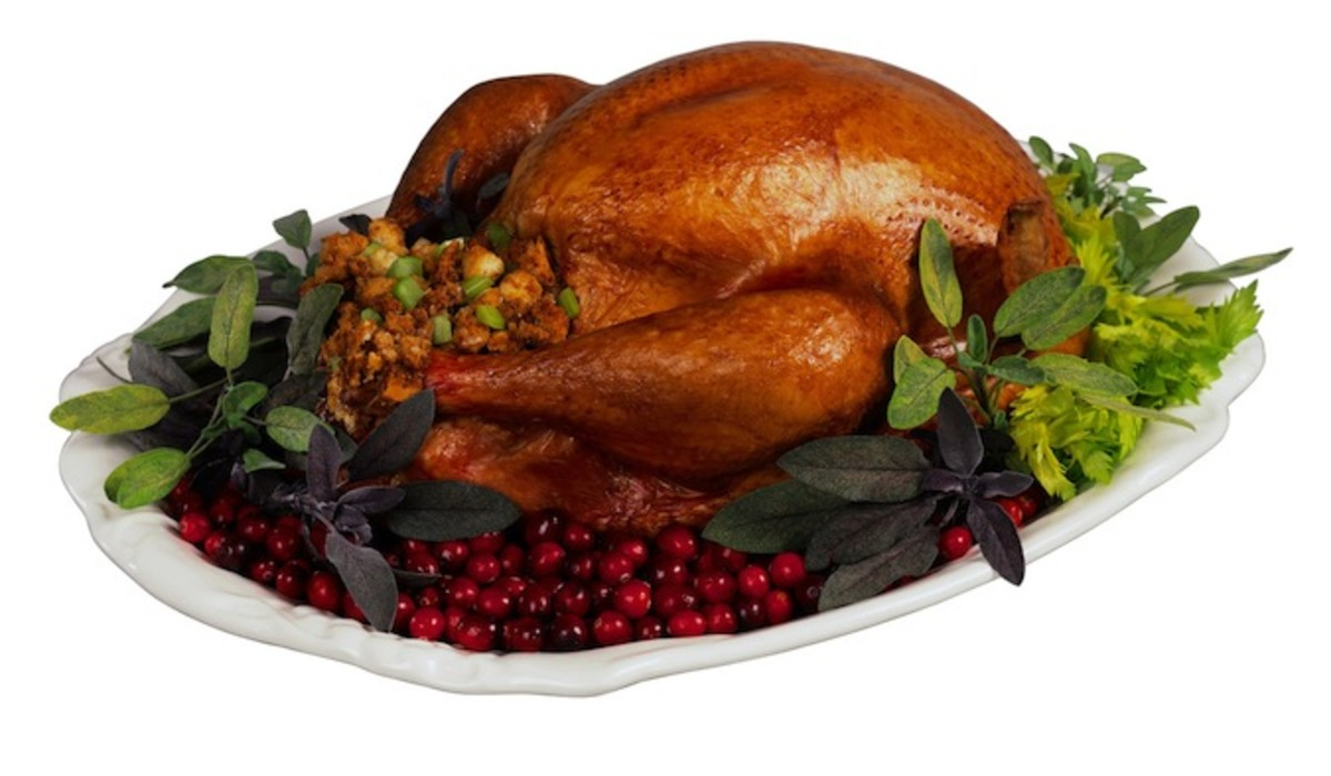 Roasted Turkey with Celery Stuffing on Platter with Cranberries