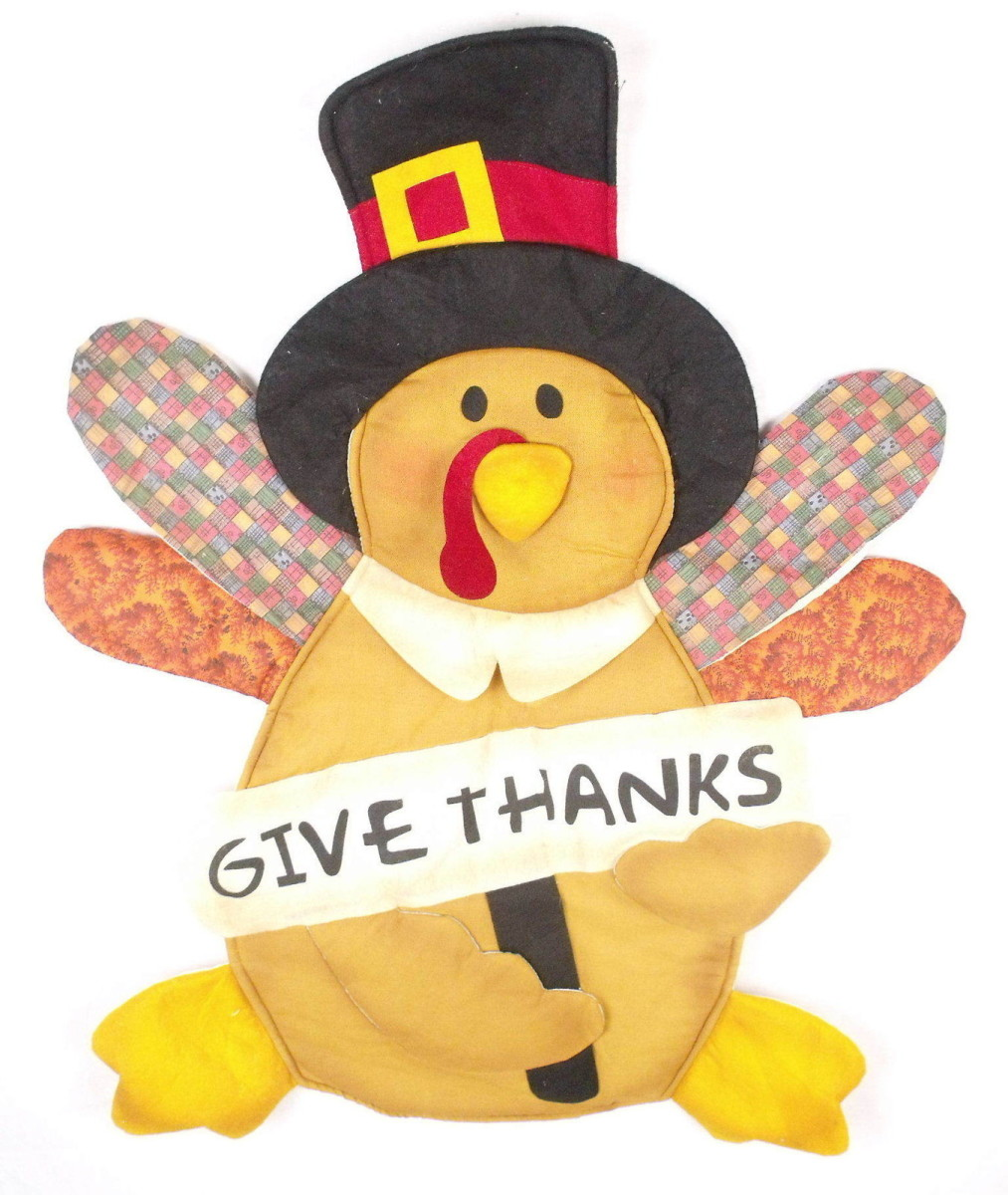 Turkey with Give Thanks Sign