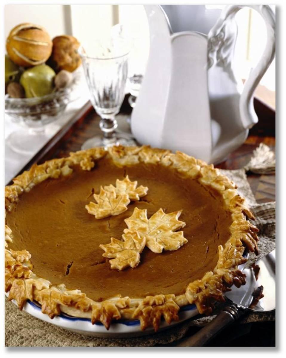 Pumpkin Pie with Pie Crust of Autumn Leaves Design