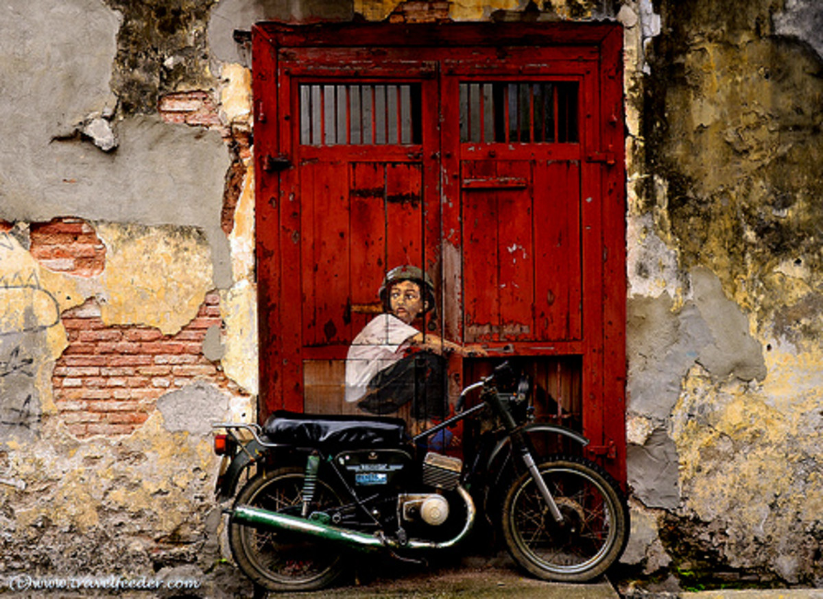 Street mural by Ernest Zacharevic during George Town Festival 2012