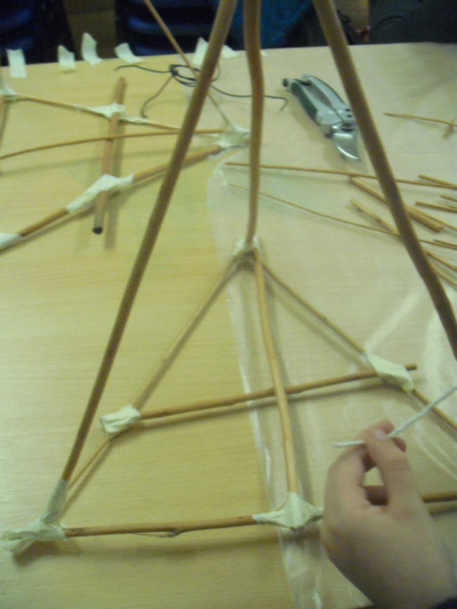 Use masking tape to secure the cross shape across your triangle.