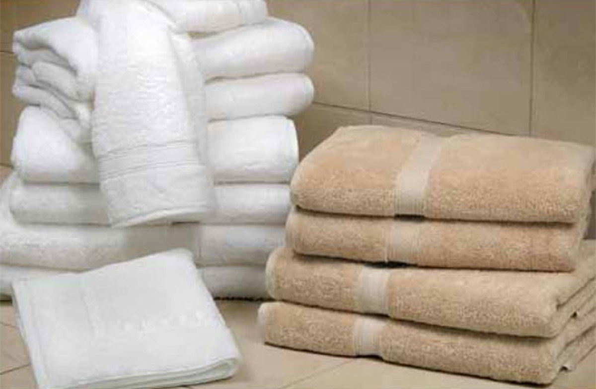 The 1888 Mills Luxury towel is available in white, clay, ivory, and moss colors.