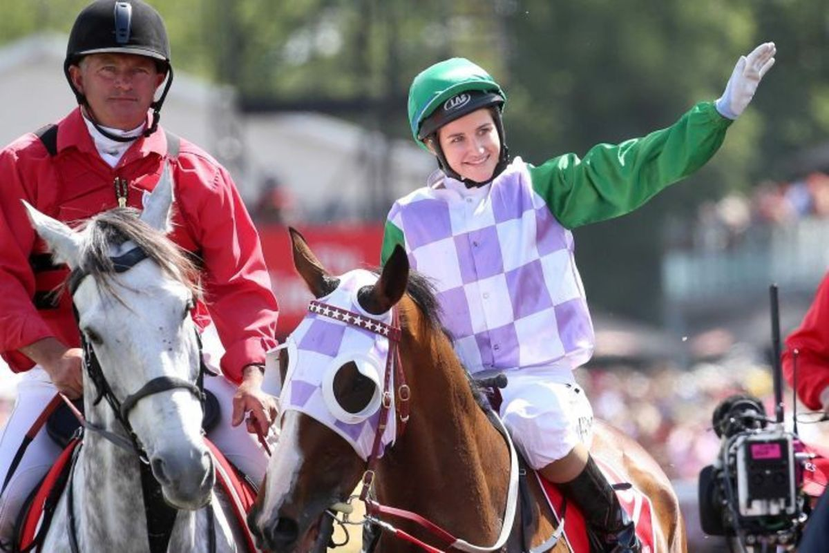 Michelle Payne on Prince of Penzance waves to the crowd after winning the 2015 Melbourne Cup.