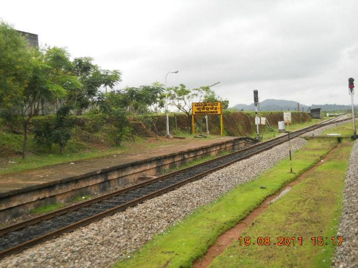 Murudeshwara Railway Station. From here it is just 2 km to reach the temple and beach.