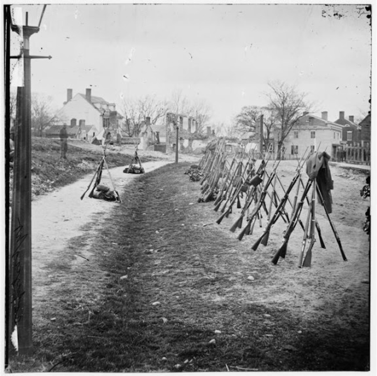 Stacks of muskets indicate a camp of infantry nearby