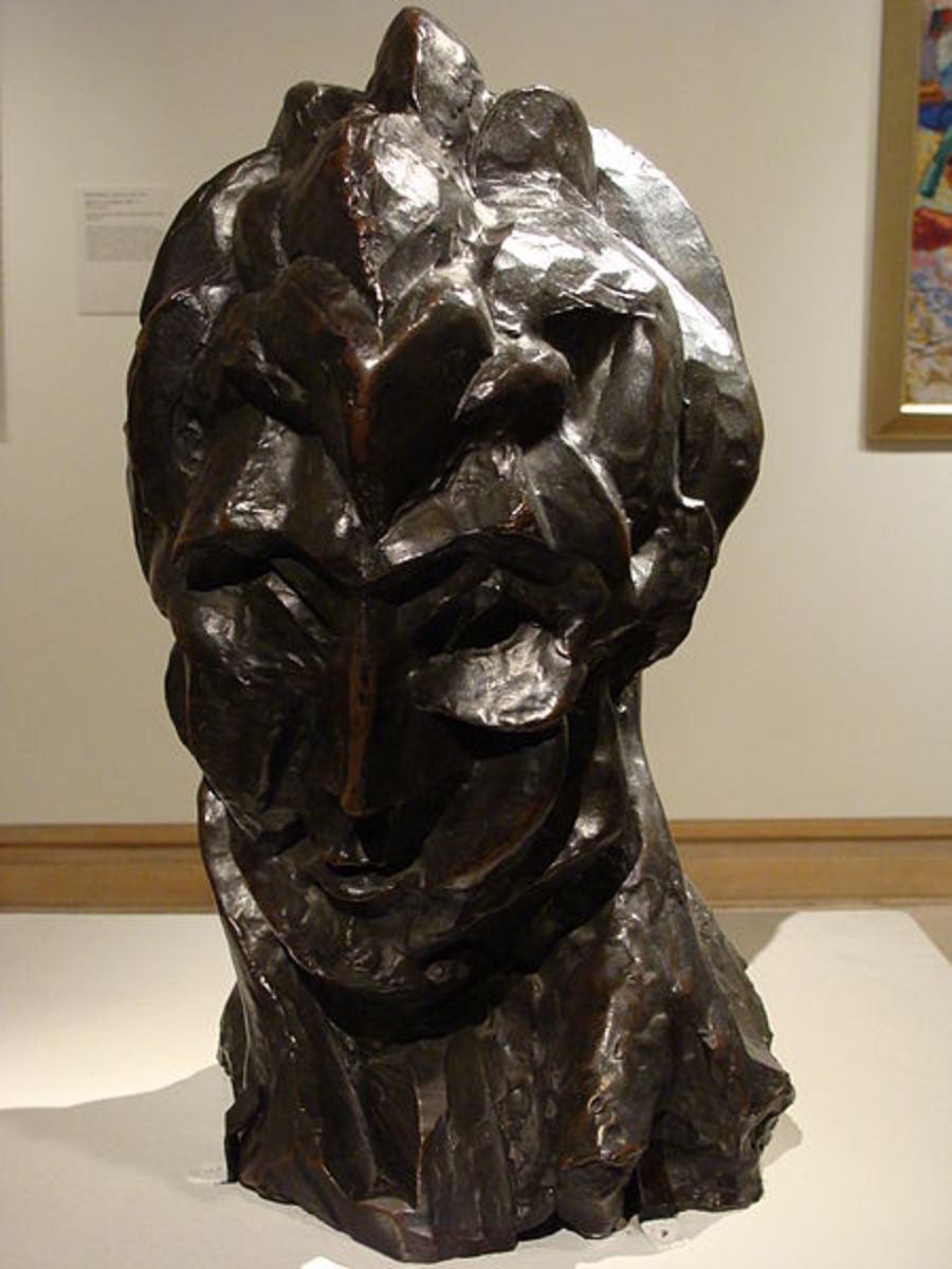 "Pable Picasso created this Woman's Head constructed sculpture in 1909. Rather than ""taking away"" as in traditional sculpture, Picasso ""added to"" the piece."