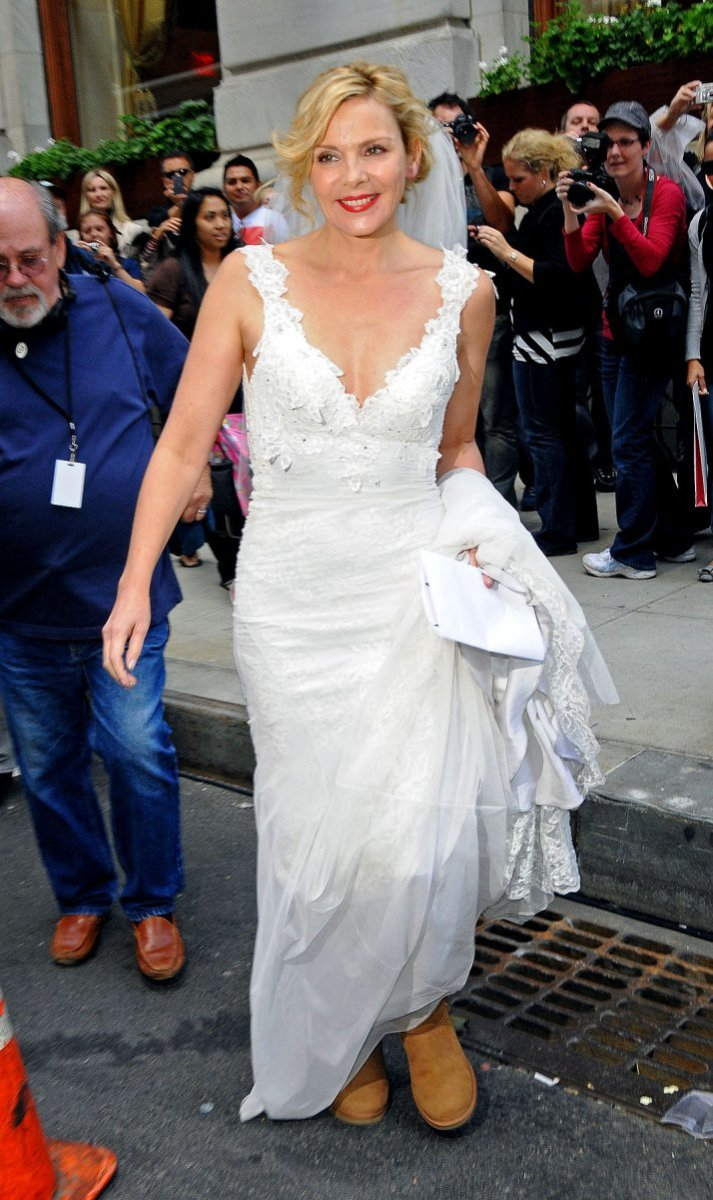 Kim Cattrel as Samantha wearing a wedding dress and Ugg boots