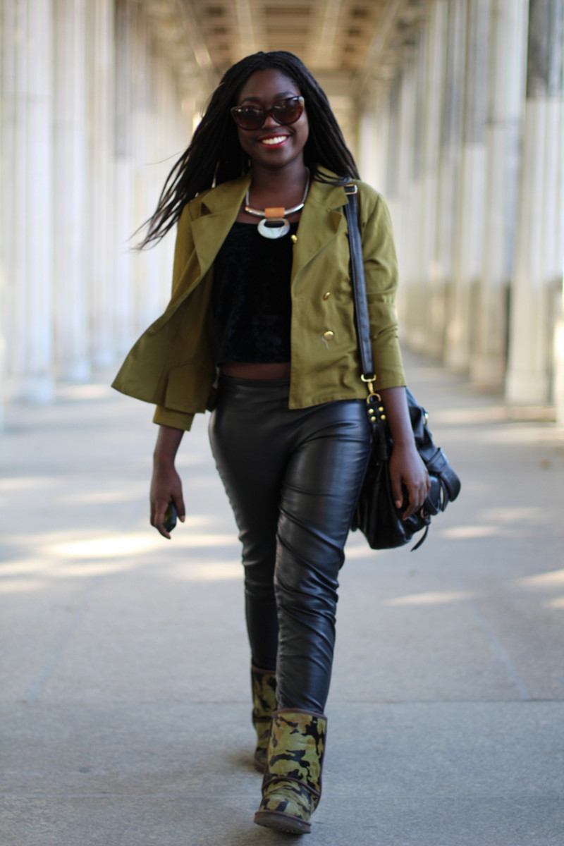 beautiful black girl in army green jacket blue jeans and camouflage color Uggs