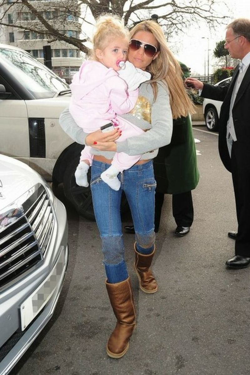 Katie Price in leather sheep skin lined boots in tight blue jeans