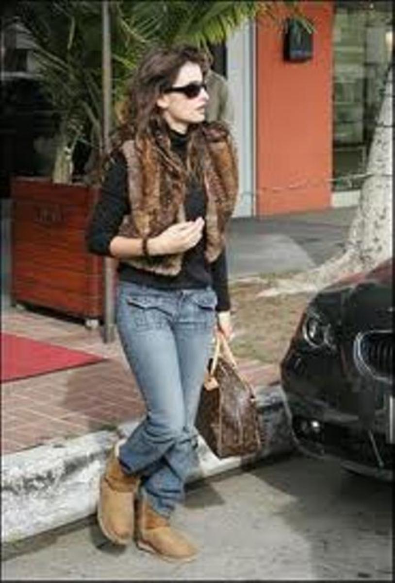 UGGs with blue jeans with a fur vest