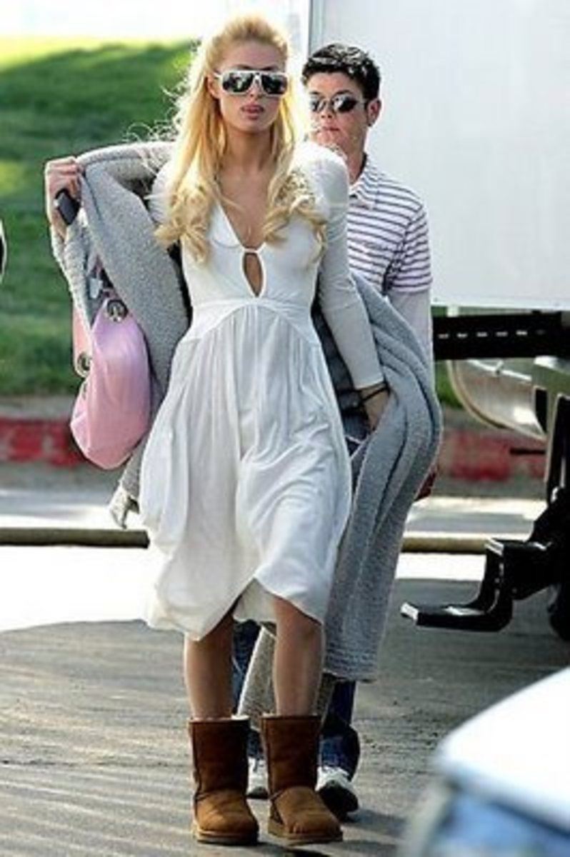 Paris Hilton in a white sun dress and Ugg boots